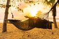 Empty hammock swing around beach sea ocean at sunset or sunrise time - PhotoDune Item for Sale