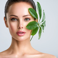 Young beautiful woman with green leave near face and body. - PhotoDune Item for Sale