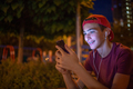 Portrait of a smiling young man with a smartphone, in the street. - PhotoDune Item for Sale