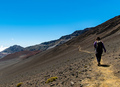 Woman with Backpack Walking in a Crater of an Inactive Volcano in Haleakala National Park - PhotoDune Item for Sale