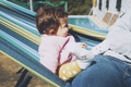 Little baby having fun on a hammock in a sunny day - PhotoDune Item for Sale