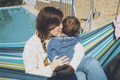 Image about real motherhood of a young mom hugging her baby - PhotoDune Item for Sale