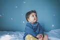 Little baby surrounded by rainbow lights - PhotoDune Item for Sale