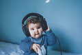 Little baby playing with her daddy's headphones - PhotoDune Item for Sale