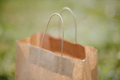 eco paper bag on grass outdoors - PhotoDune Item for Sale