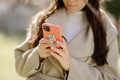 smiling woman using smartphone and holding money for online payment - PhotoDune Item for Sale