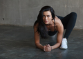 athletic woman stretching legs in brutal gym - PhotoDune Item for Sale