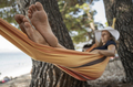 Woman enjoying and resting in range hammock looking at the sea - PhotoDune Item for Sale