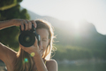 Smiling young woman taking photo directly at the camera - PhotoDune Item for Sale