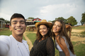 Three Friends Using Smart Phone for Photograph With the Horses in the Ranch - PhotoDune Item for Sale