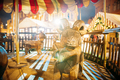 Riga, Latvia. Traditional Vintage Old Carousel Merry-go-round On Christmas Market On The Dome Square - PhotoDune Item for Sale