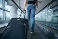 Man walking with suitcase at airport terminal - PhotoDune Item for Sale