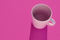Pink mug over a purple background. Morning breakfast. Design porcelain - PhotoDune Item for Sale