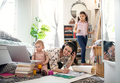 Mother working with small daughters in bedroom, home office concept - PhotoDune Item for Sale