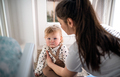 Mother with small toddler daughter in bedroom at home - PhotoDune Item for Sale