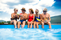 Group of cheerful seniors sitting by swimming pool outdoors in backyard - PhotoDune Item for Sale