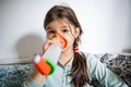 Portrait of sick small girl at home, using inhaler - PhotoDune Item for Sale