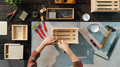 Top view of unrecognizable woman making wooden boxes, small business and desktop concept - PhotoDune Item for Sale