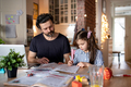 Father with small daughter in kitchen, distance learning, home office and schooling concept - PhotoDune Item for Sale