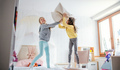 Two small girls sisters indoors at home, pillow fight in bedroom - PhotoDune Item for Sale