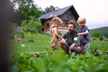 Small children with father working in vegetable garden, sustainable lifestyle - PhotoDune Item for Sale