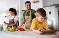 Happy family in the kitchen having fun and cooking together - PhotoDune Item for Sale