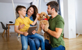 Happy family using technology devices together at home - PhotoDune Item for Sale