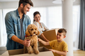 Husband and wife and their son with pet moving in new home - PhotoDune Item for Sale