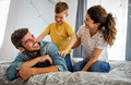 Young happy family having fun, playing together at home - PhotoDune Item for Sale
