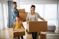 Happy family with cardboard boxes in new house at moving day - PhotoDune Item for Sale