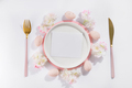 Easter table place setting with eggs, plate, cutlery and beautiful flowers with card - PhotoDune Item for Sale