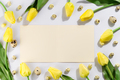 Colorful easter quail eggs and tulips on white background with brochure. Flat lay - PhotoDune Item for Sale