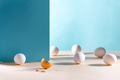Easter background. White eggs with golden shell on a blue background - PhotoDune Item for Sale