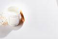 Soy candles in white glass bottles with cover and dry flower, on a white background - PhotoDune Item for Sale