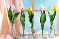 Color fresh tulips in a vase on a table with Easter eggs - PhotoDune Item for Sale