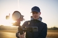 Man filming with camera and gimbal against at beautiful sunrise - PhotoDune Item for Sale