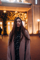 Girl on the background of the illuminated entrance to the building - PhotoDune Item for Sale