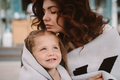 Cute little girl and her beautiful young mom hug each other - PhotoDune Item for Sale