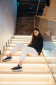 Young beautiful brunette fashion model posing on stairs - PhotoDune Item for Sale