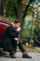 Young man in formal clothes walks in the autumn park - PhotoDune Item for Sale