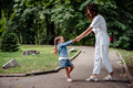 Lovely young mom and daughter in sunny day, happy family - PhotoDune Item for Sale