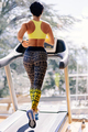 young attractive woman running on treadmill in sport gym - PhotoDune Item for Sale