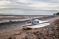 Old rusty boat on Thurstaston beach during low tide - PhotoDune Item for Sale
