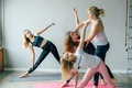 Yoga instructor teaches teenage girls in yoga class. Sports healthy discipline. - PhotoDune Item for Sale