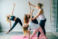 Three teenage girls doing yoga in the gym with the instructor. Healthy sports lifestyle. - PhotoDune Item for Sale