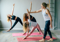 Three teenage girls doing yoga in the gym with the instructor. A healthy active sports lifestyle. - PhotoDune Item for Sale