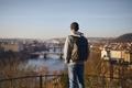 Man looking at urban skyline at sunrise - PhotoDune Item for Sale