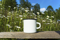 Placeit-White campfire enamel mug mockup with daisy field - PhotoDune Item for Sale