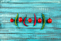 cherry tomatoes and chilli peppers on turquoise wooden table top texture. fresh seasonal vegetables - PhotoDune Item for Sale