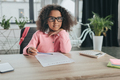 little african american girl pretending to be businesswoman and doing paperwork in office - PhotoDune Item for Sale